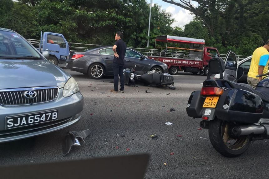 A man in his 40s was killed when he got trapped under a car.