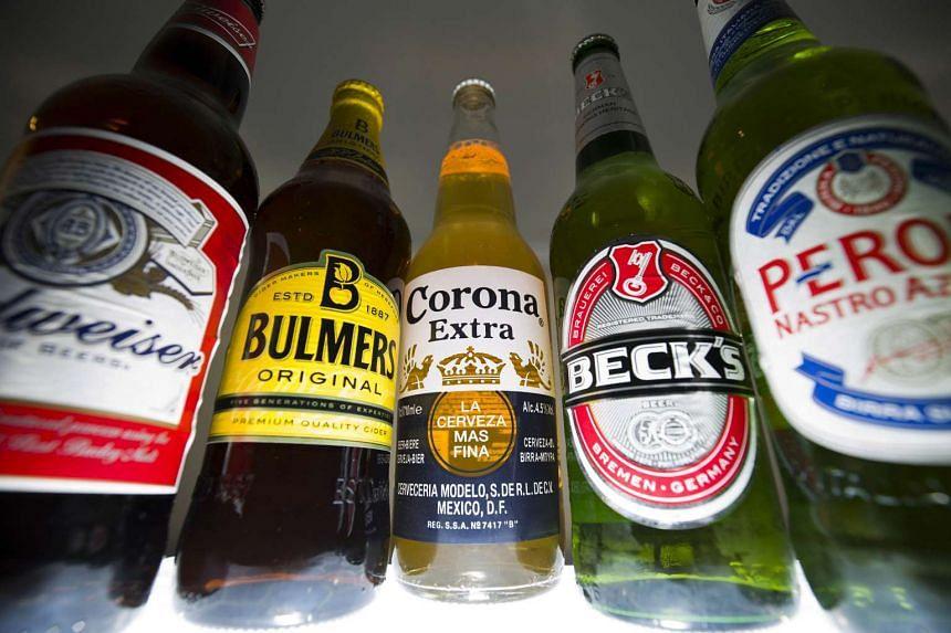 Bottles of beer and cider produced by Anheuser-Busch InBev and SABMiller.