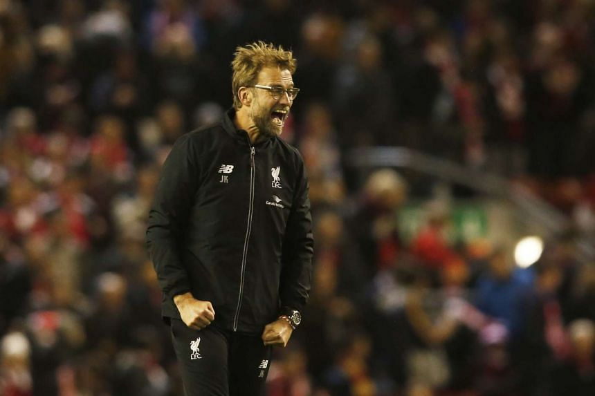 Juergen Klopp celebrates after the game against Leicester.