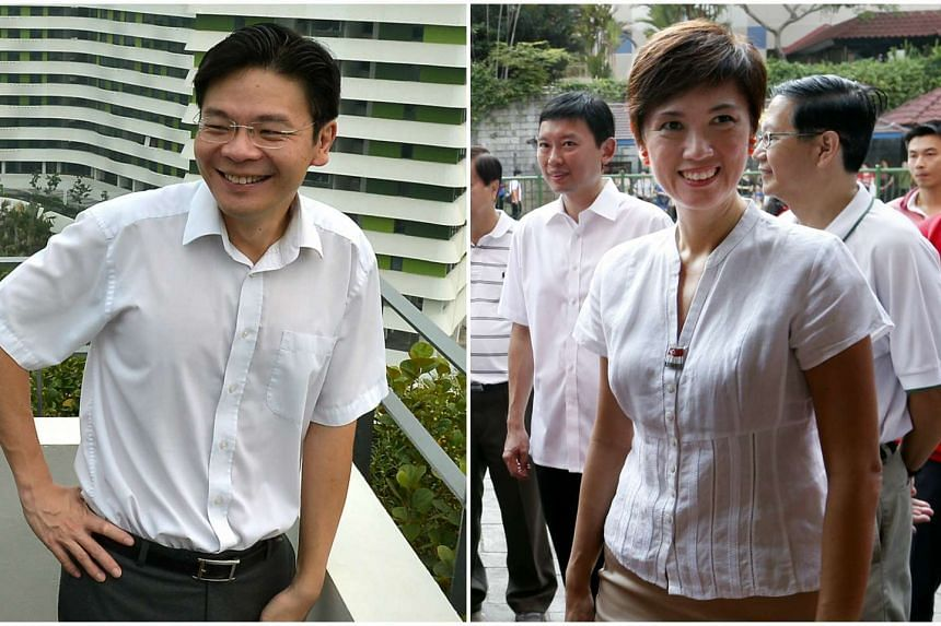 Cabinet ministers, Lawrence Wong (left) and Josephine Teo.