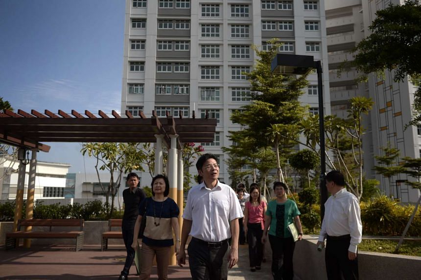 Minister for National Development Lawrence Wong (centre) tours the rooftop garden of Tampines Greenlace.