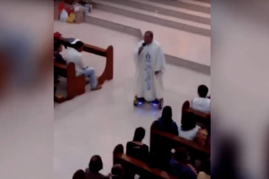 The priest is seen in the video riding a hoverboard while celebrating Christmas Eve Mass.