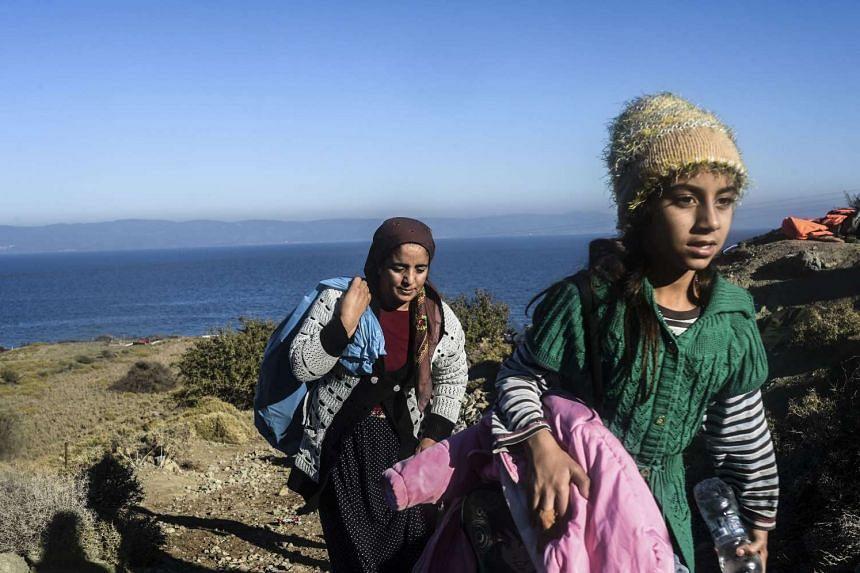 Members of the Yazidi community fleeing ISIS land on the Greek island of Lesbos.