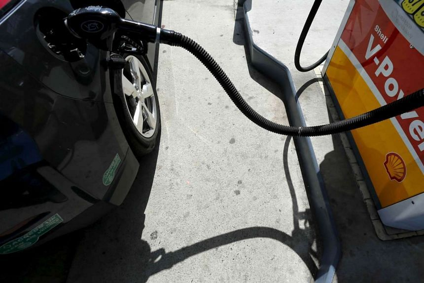 A car is filled with gasoline at a gas station pump in Carlsbad, California.