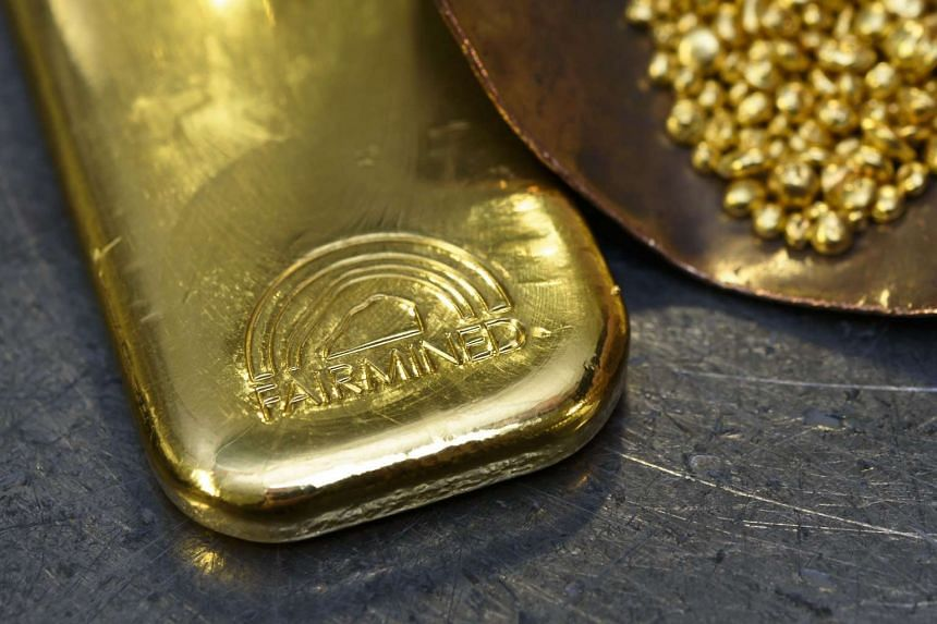 Gold was little changed on the last trading session of the year, but looked set to post its third straight annual loss.