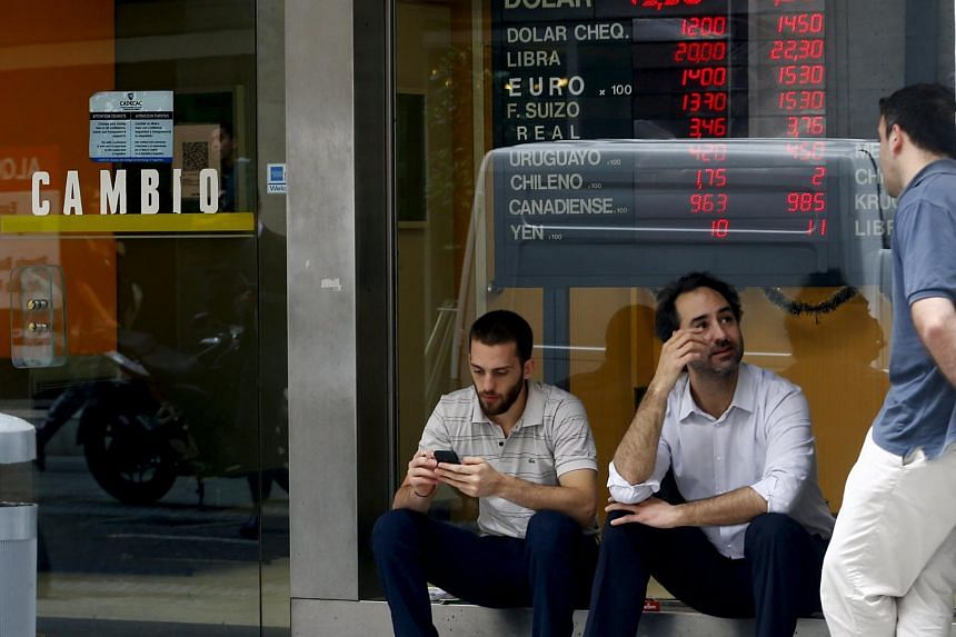 People talking outside a money exchange in Buenos Aires on Dec 17.