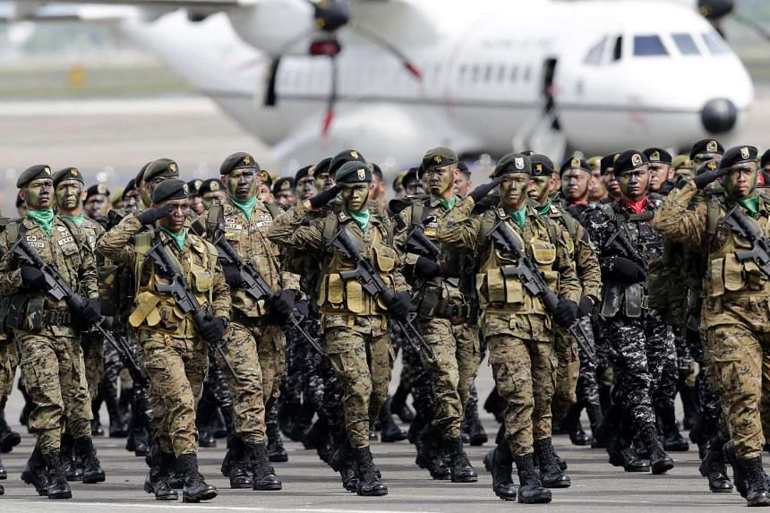 Filipino commando soldiers parade at Clark airbase in Angeles City, Philippines on Dec 21.