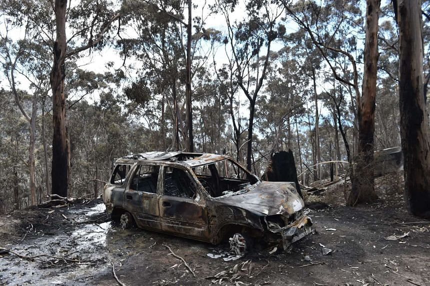 A fire damaged car is seen at Wye River in the Otway Ranges south of Melbourne, Australia on Dec 27.