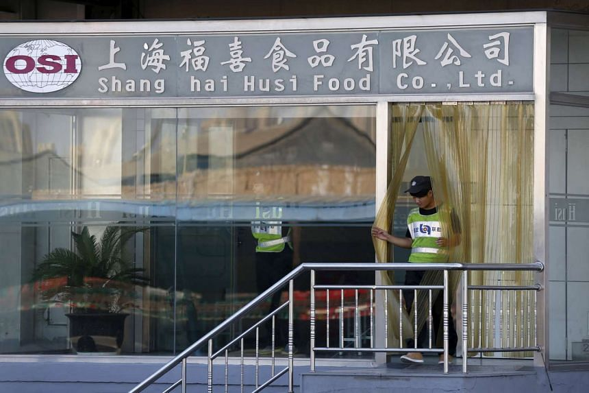 A man walks out of the entrance of Husi Food factory in Shanghai.