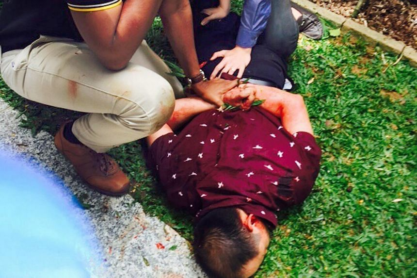 The man being pinned down by two others had allegedly attacked a victim with a knife and tried to make away with the victim's laptop bag on Nov 14.