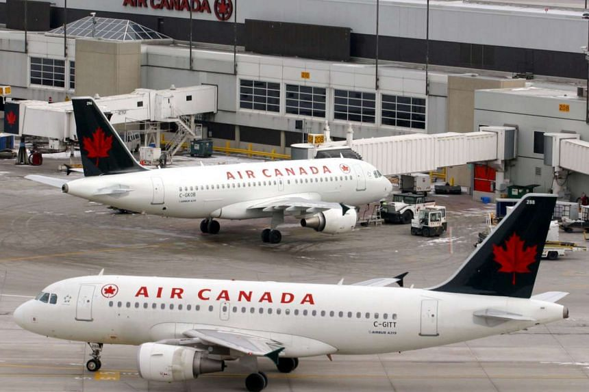 Air Canada jets parked at Toronto's Pearson International Airport. An Air Canada flight from Shanghai to Toronto made an emergency landing in Calgary on Wednesday (Dec 30) so that several people injured in severe turbulence could get treatment.