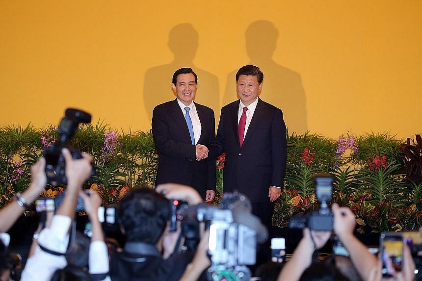 China President Xi Jinping shaking hands with Taiwanese President Ma Ying-jeou during their historic meeting at Shangri-La Hotel in Singapore on Nov 7. Professor Alfred Peng Peigen from Tsinghua University's School of Architecture is fronting the cam