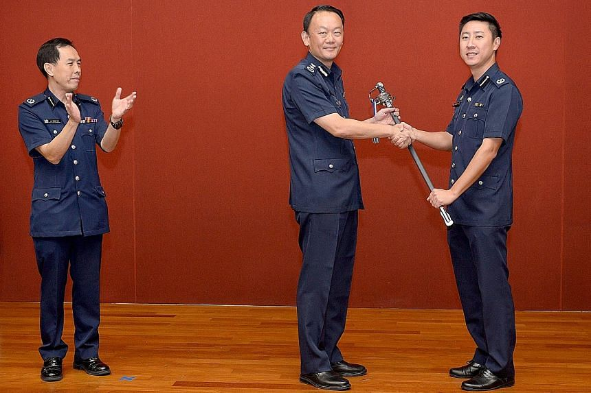 From left: Deputy Assistant Commissioner (DAC) Lu Yeow Lim's command of Tanglin Division being symbolically handed over via Police Commissioner Hoong Wee Teck to DAC Tan Chia Han in a ceremony yesterday. DAC Tan will assume his role tomorrow, while D