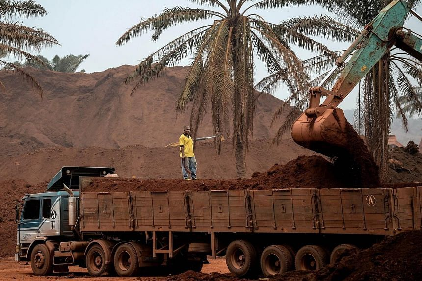 An excavator loading a truck with bauxite-rich earth on Oct 13 in Bukit Goh, Pahang. Residents have complained of contamination of water sources and environmental destruction due to mining operations.
