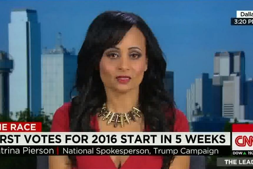Katrina Pierson wearing the bullet necklace on CNN.