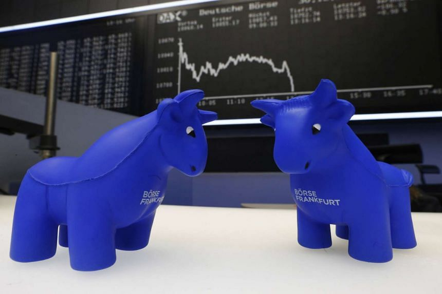 Foam bull figures in front of the German DAX Index board during the last trading day at Frankfurt's stock exchange.