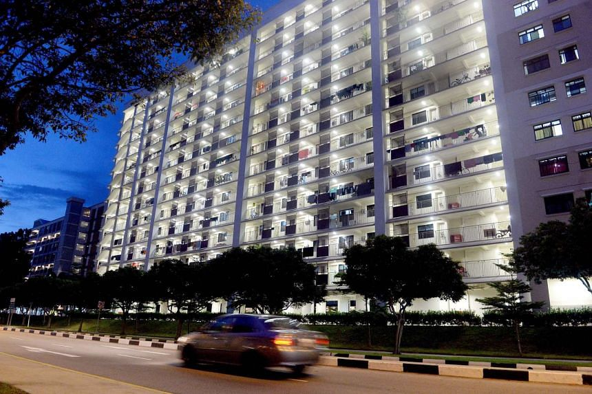 A HDB block in Tampines lit up at night.