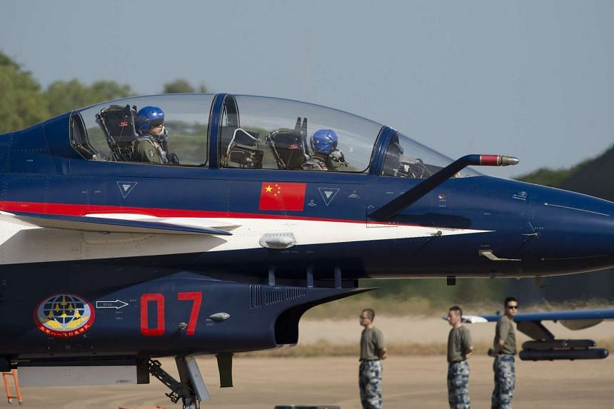 A Chinese J-10 aircraft from the People's Liberation Army Air Force prepares to take off during at an air base in Korat on Nov 24.