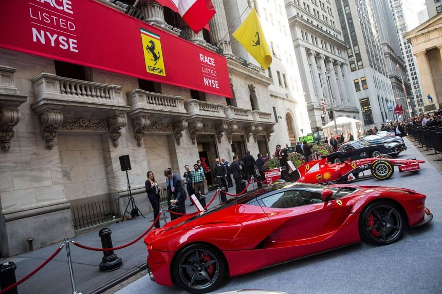 A Ferrari is parked outside the New York Stock Exchange in celebration of Ferrari Automotive Company's IPO on Oct 21, 2015 in New York City. Ferrari will trade under the symbol RACE.