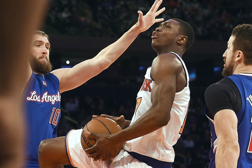 Cleanthony Early (centre) of the New York Knicks drives to the basket against the Los Angeles Clippers at Madison Square Garden in New York in March.