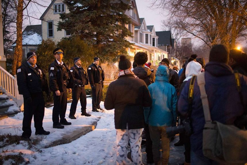 Protesters rally outside the home of Mayor Rahm Emanuel on Dec 29, 2015.