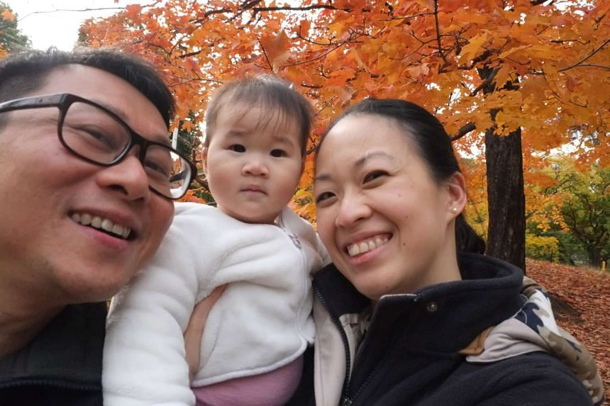 Film-maker Kelvin Tong with his wife Xueying and daughter Kei An.