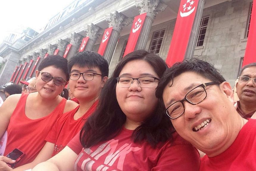 Families for Life council member Anita Fam (far left) with her husband Goh Eck Kheng, 60, and their children Gillian, 16 and Timothy, 14.