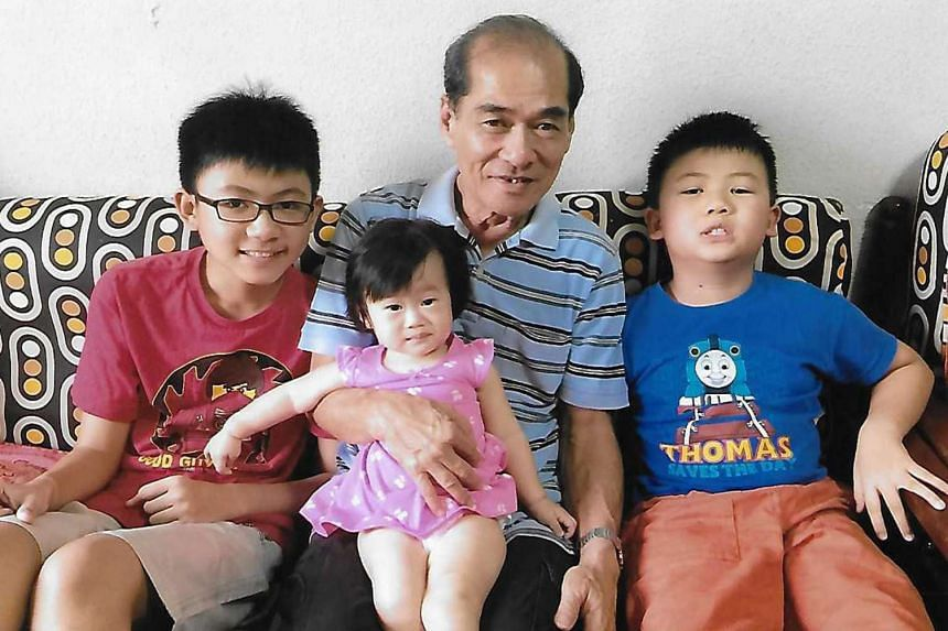 Mr Koh Yan Aun with his grandchildren (from left) Adam Chim, 13, Koh Jing Xuan, one, and Andrew Chim, eight.