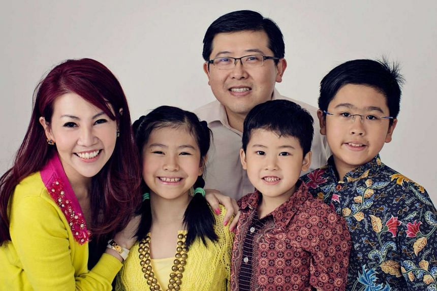 Jenny Wee with her husband Kevin Teo, 43, and their children (from left) Ashley, nine, Isaac, seven and James, 12.