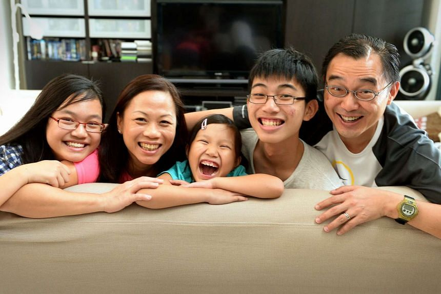 Ms Theresa Tan with her husband Kevin Ng, 48, and their children (from left) Bethany, 14, Becca, nine, and Bruce, 16.