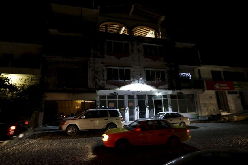 Cars drive past a building where mother and son stayed in Puerto Vallarta, Mexico.
