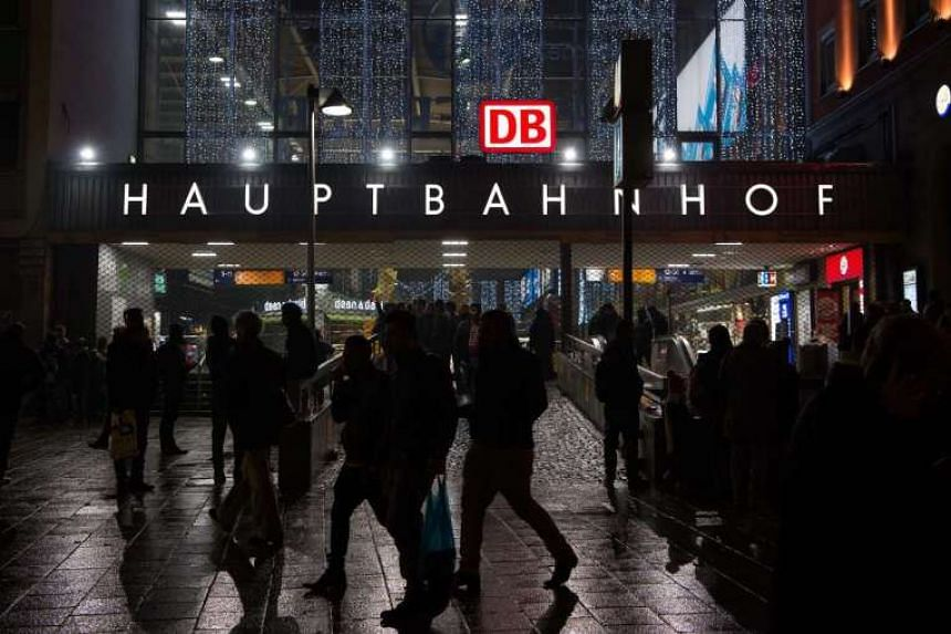 People walk past the main railway station in central Munich, Germany on Dec 31, 2015.