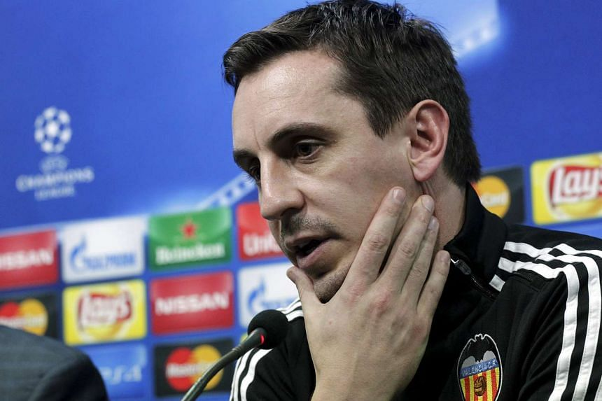 Valencia's coach Gary Neville attends a news conference.