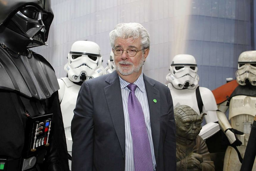 Lucasfilm founder, George Lucas surrounded by Darth Vader and Storm Troopers during the official opening of Lucasfilm's regional headquarters in Buona Vista.