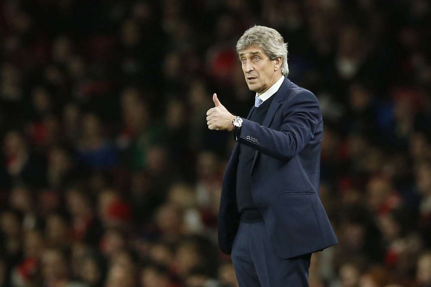 Manchester City manager Manuel Pellegrini reacts during the match against Arsenal.