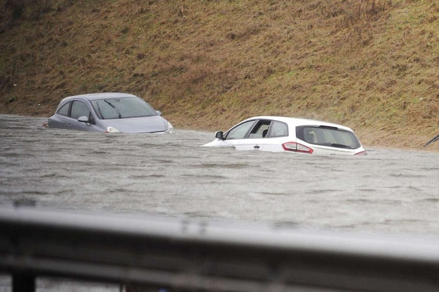 Cars are submerged in floodwater on a carriageway in Biggar, Scotland on Dec 30, 2015.