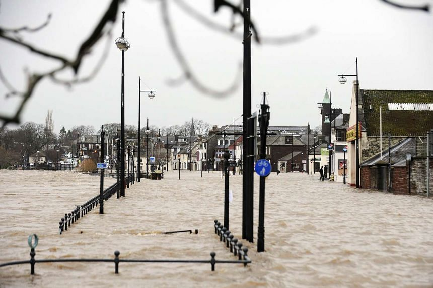 Pedestrian areas flooded along the River Nith that burst its banks in Dumfries, Scotland on Dec 30, 2015.