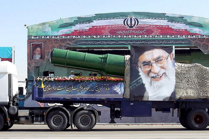 A military truck carrying a missile and a picture of Iran's Supreme Leader Ayatollah Ali Khamenei is seen during a parade marking the anniversary of the Iran-Iraq war.