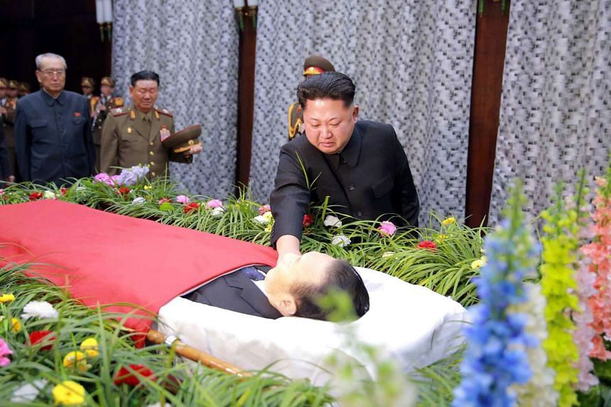 This picture taken by North Korea's official Korean Central News Agency (KCNA) on Dec 31, 2015 shows North Korean leader Kim Jong Un looking at the body of Mr Kim Yang Gon, head of the North Korea's ruling Workers' Party's unification front departmen