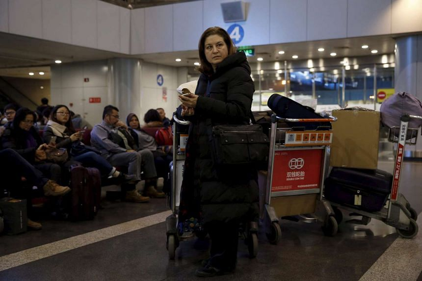 Ursula Gauthier waits at Beijing international airport before her departure to France.