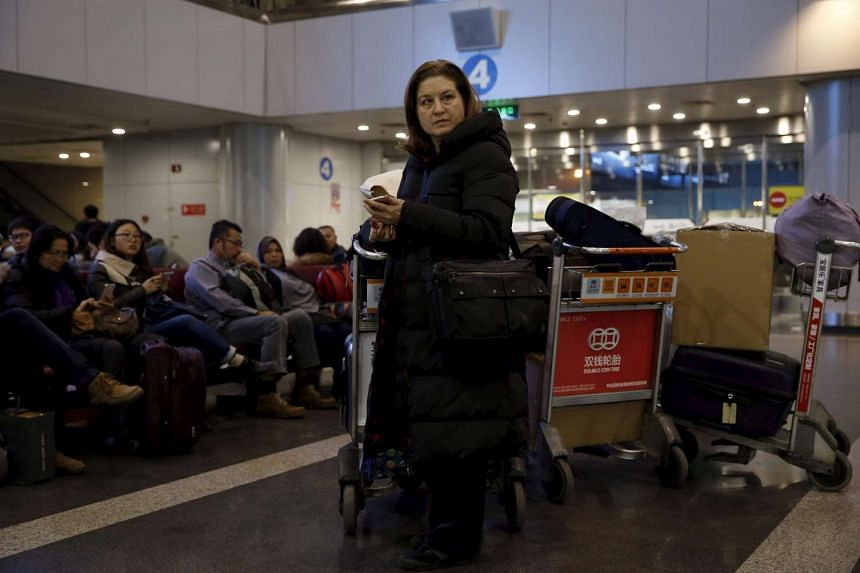 Ursula Gauthier, a reporter for the French current affairs magazine L'Obs, waits at Beijing international airport before her departure to France, in Beijing on Dec 31, 2015.