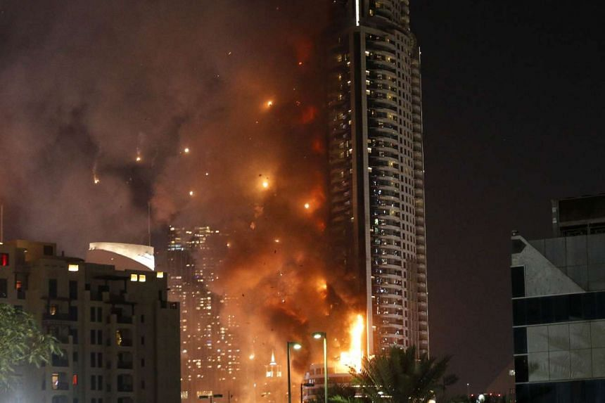 Flames rip through The Address Downtown hotel after it was hit by a massive fire, near the world's tallest tower, Burj Khalifa, in Dubai,