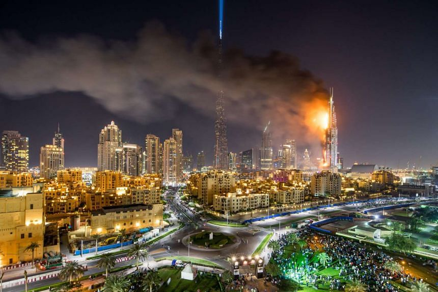 Flames and smoke were seen billowing from The Address Downtown hotel in Dubai after a fire broke out at the skyscraper.