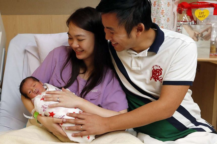 Mr Tan Nan An and Ms Chen Yi Feng with their first child, Evan.