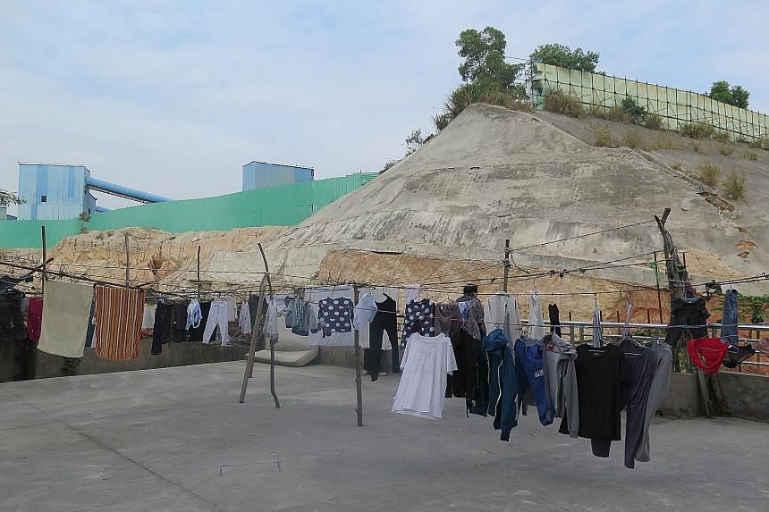 The stone quarry with a huge mountain of sand that can be seen from Mr Dai Guanchao's apartment complex in Shenzhen's Longgang district. Residents living near such sites are waking up to the dangers they pose, in the wake of a landslide last month wh