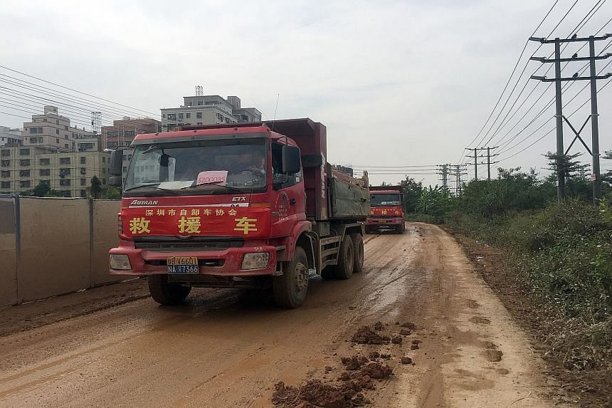 """(Left) Trucks loaded with soil leaving the site of the landslide. Nearby resident Chen Yulin (above) says the incident is """"a man-made tragedy that could have been prevented""""."""