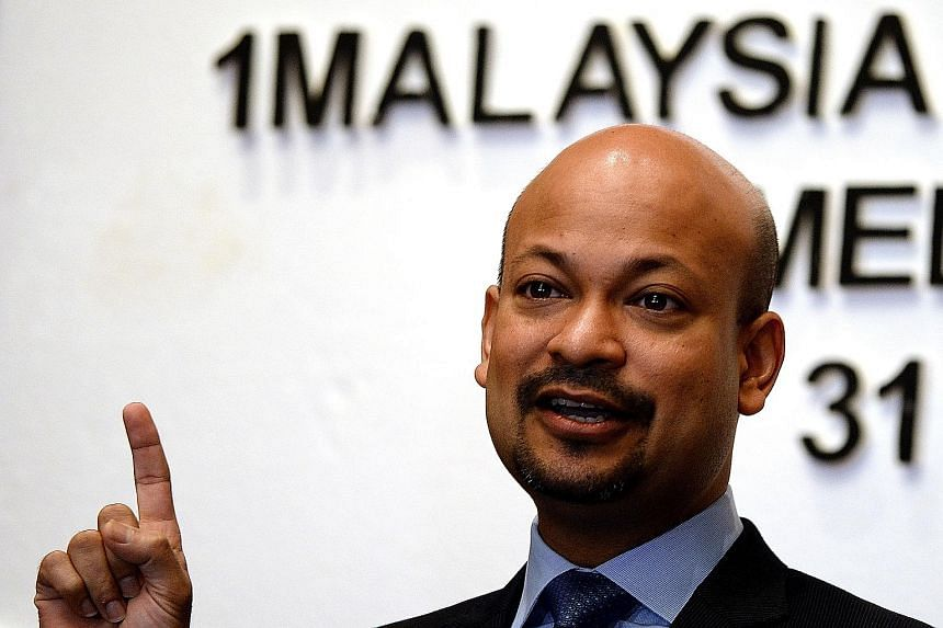 The Bandar Malaysia site now houses the Sungai Besi air force base (left) and other government facilities. 1MDB's Mr Arul Kanda Kandasamy (above) sidestepped a question on whether IWH-CREC had overpaid for the stake.
