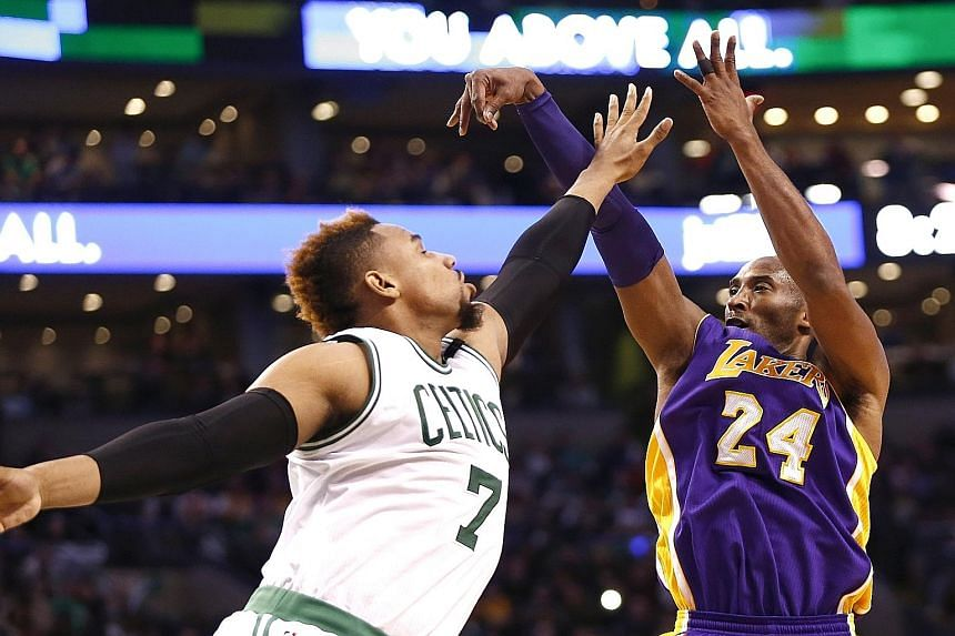 Lakers star Kobe Bryant (right) shooting the ball over Celtics centre Jared Sullinger. The Lakers won 112-104 to end a four-game losing streak.