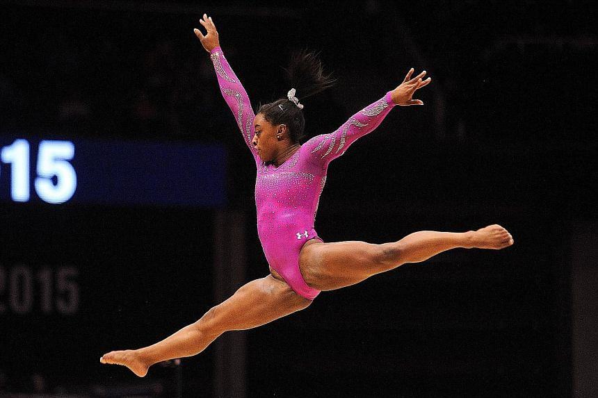 US gymnast Gabrielle Douglas competing at last year's World Gymnastics Championships. The Olympic all-around champion is seeking to make the five-woman team for the Olympic Games in Rio de Janeiro in August.