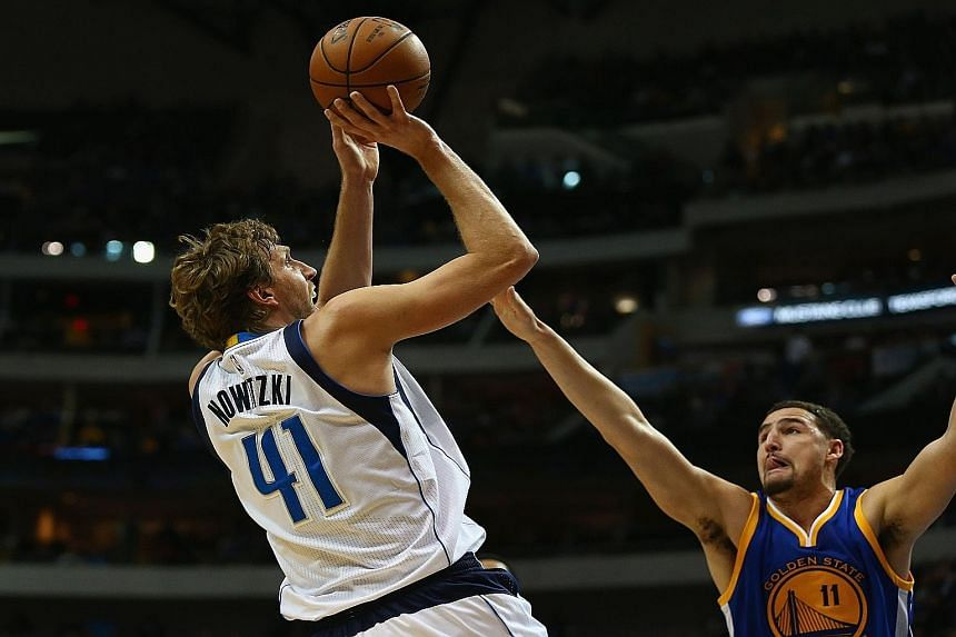Dallas' Dirk Nowitzki taking a shot as Golden State's Klay Thompson blocks him. The NBA champions sorely missed MVP Stephen Curry as they succumbed 91-114 for just their second defeat of the regular season.